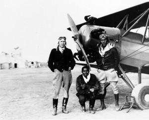 Pioneer Aero Club members Gilbert, right, and Marie, left, and a friend next to airplane at a stop between Los Angeles and San Diego, c. 1930. Shades of L.A. Collection.