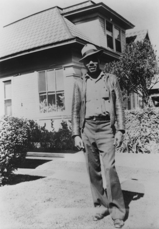Raymond Austin in front of home