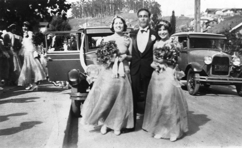 Bridesmaids and best man at a wedding party in Chávez Ravine, Shade of L.A.: Mexican American Community, Image #00002754, 1929.