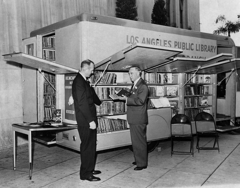 Harold Hamill and Harold Henry inspect bookmobile